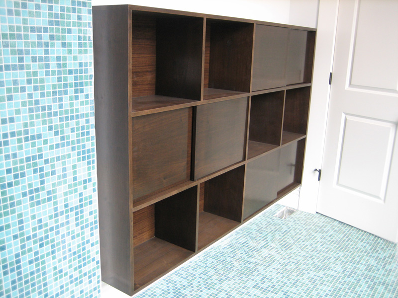 Walnut ply bathroom cabinet with sliding doors for The Randolph House.