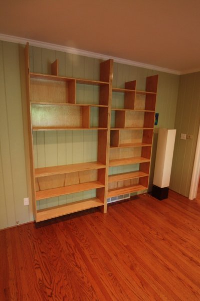 Exposed-edge plywood bookshelves built for a couple of ghost-writers.