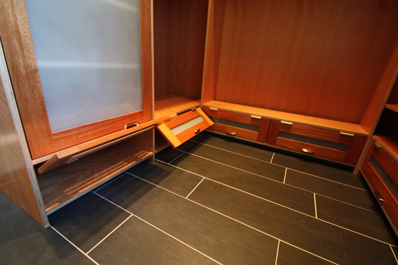 Detail of master closet showing lower shoe doors. Note torsion-stay hinges.