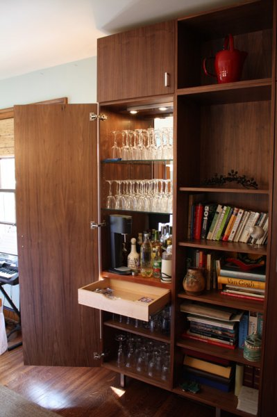 Bar area of walnut ply dining room cabinets.