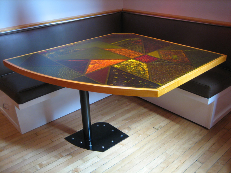 Dining nook for Pat\'s place. Table consists of items embedded in different colors of resin.