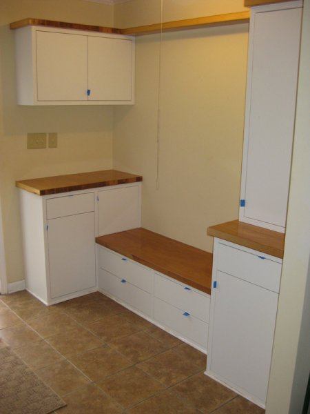 Mudroom cabinets built for my aunt and uncle. Countertops are reclaimed solid-core doors.