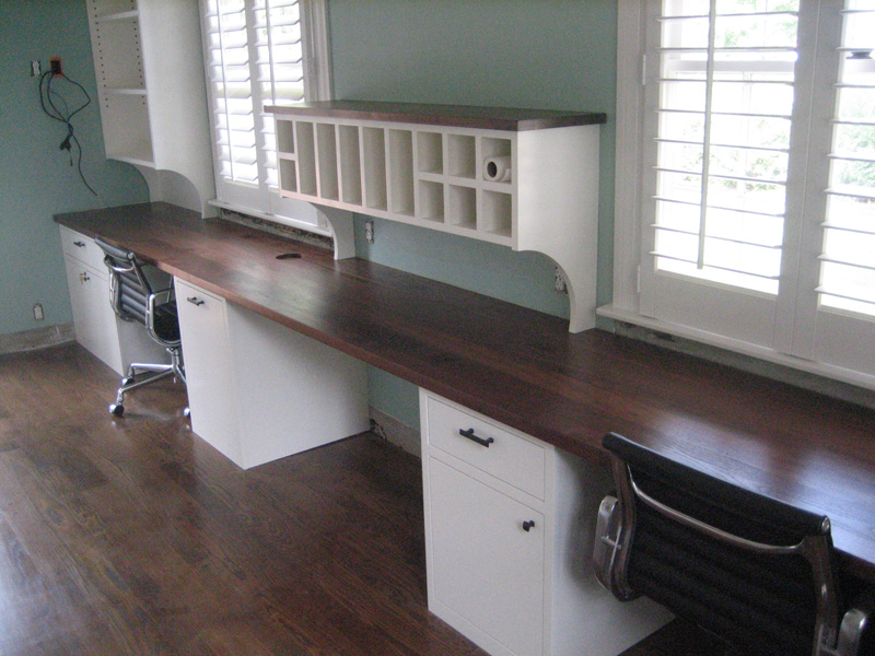 Office with custom cabinets and reclaimed walnut countertops.