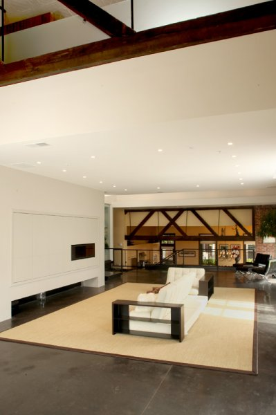 Panelized wall around fireplace and built large folding pocket doors to conceal TV on left.