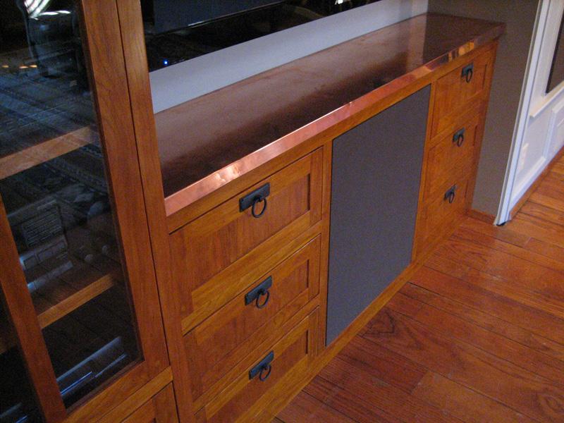 Cherry media center with copper countertop. Glass in doors is old, reclaimed wavy sort.