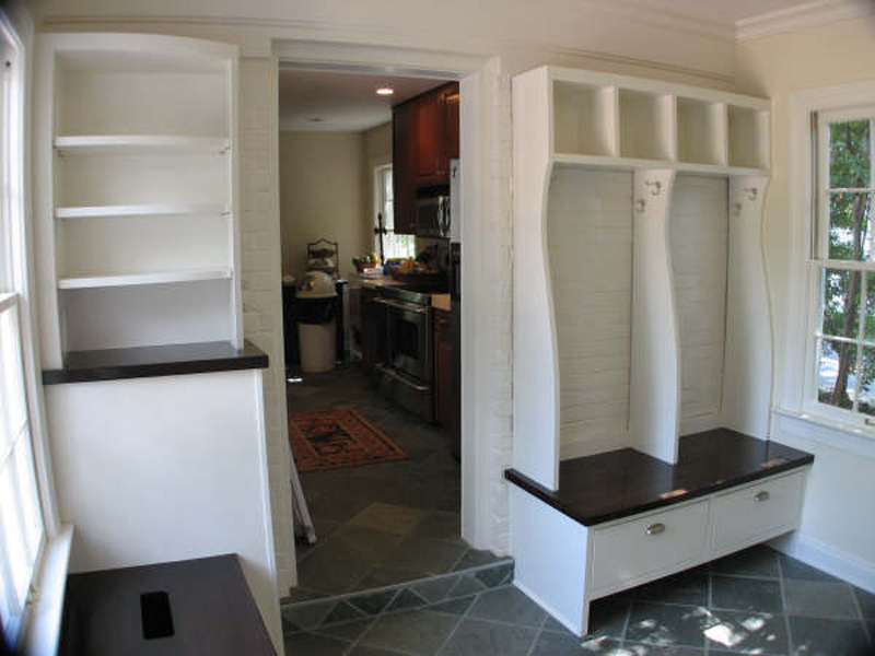 Mudroom with cubbies, garbage and recycling drawers. Countertops are stained maple. Finishing by Jenny Wuest.