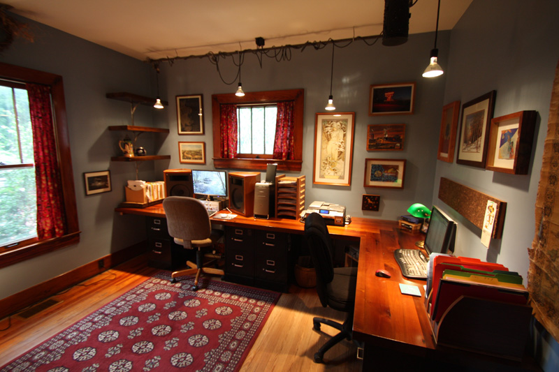 Our home office. Countertops are reclaimed poplar, light fixture is made from plumbing we ripped out of our house.