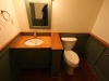Bathroom vanity, wainscot, privacy wall and mirror. Tops are urban-forested cherry.