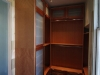 Master closet made from figarossa ply and solid wood. Doors have sandblasted glass panels.