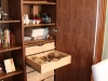 Detail of walnut ply dining room cabinets.