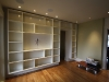 Large-scale painted wall-hanging bookshelf piece for clients on Cherokee.