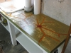 Green dyed concrete countertop with colored resin inlays.