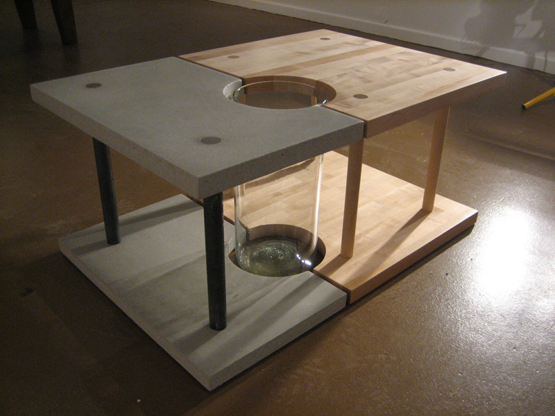 Concrete, steel, maple and glass coffee table.