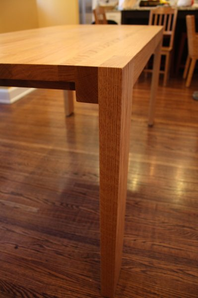 Solid oak kitchen table. Table has two leaves that make overall length about 8 feet.
