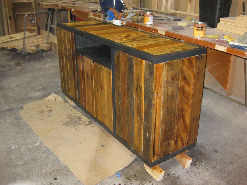 Media cabinet built from scrap plywood, reclaimed poplar and wood salvaged from old shipping pallets.