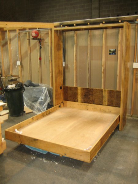 Murphy bed built from birch plywood that was salvaged from a fire.