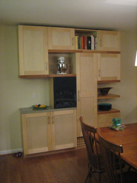 Kitchen cabinets with concrete countertops.