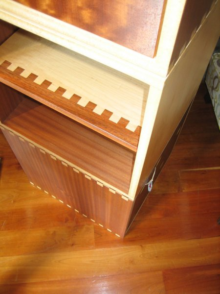 Storage cubes built out of scrap plywood, solid wood and hardware.