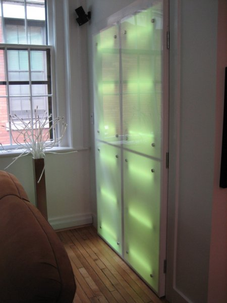 Light box doors that hide utility closet in Pat\'s place.