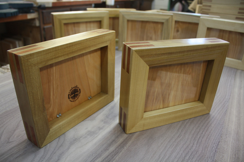Picture frames built out of urban-sourced hardwoods.