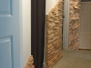 Wall skinned in strips of birch plywood.