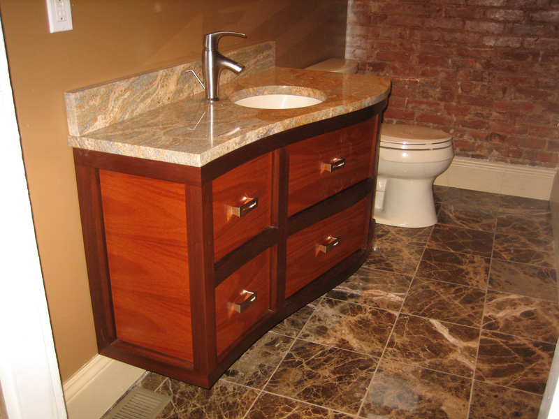 Curved vanity built from solid mahogany and mahogany plywood.