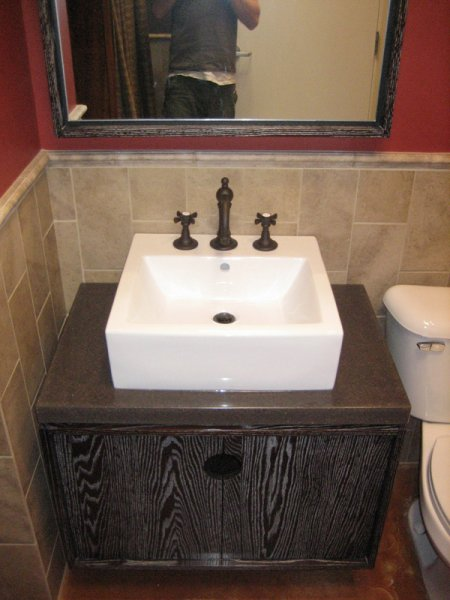 Solid oak cerused vanity with concrete countertop at Joseph\'s Salon.