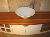 Curved vanity with solid redwood top.